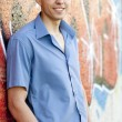 Teen boy near graffiti wall. - Stock Photo