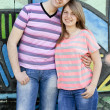 Young couple near graffiti background. — Photo