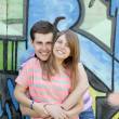 Young couple near graffiti background. — Stock Photo #10402248