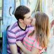 Young couple kissing near graffiti background. — Stock Photo #10402262