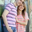 Young couple near graffiti background. — Stock Photo #10402270