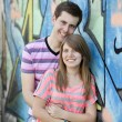 Young couple near graffiti background. — Stock Photo #10402278