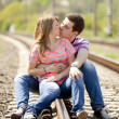 Couple kissing at railway. — Stock Photo #10402291