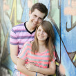 Young couple near graffiti background. — Stock Photo #10402299