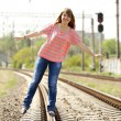 Teen girl at railways. — Stock Photo