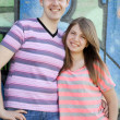 Young couple near graffiti background. — Stock Photo #10402334