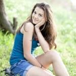 Brunette girl at summer park. — Stock Photo