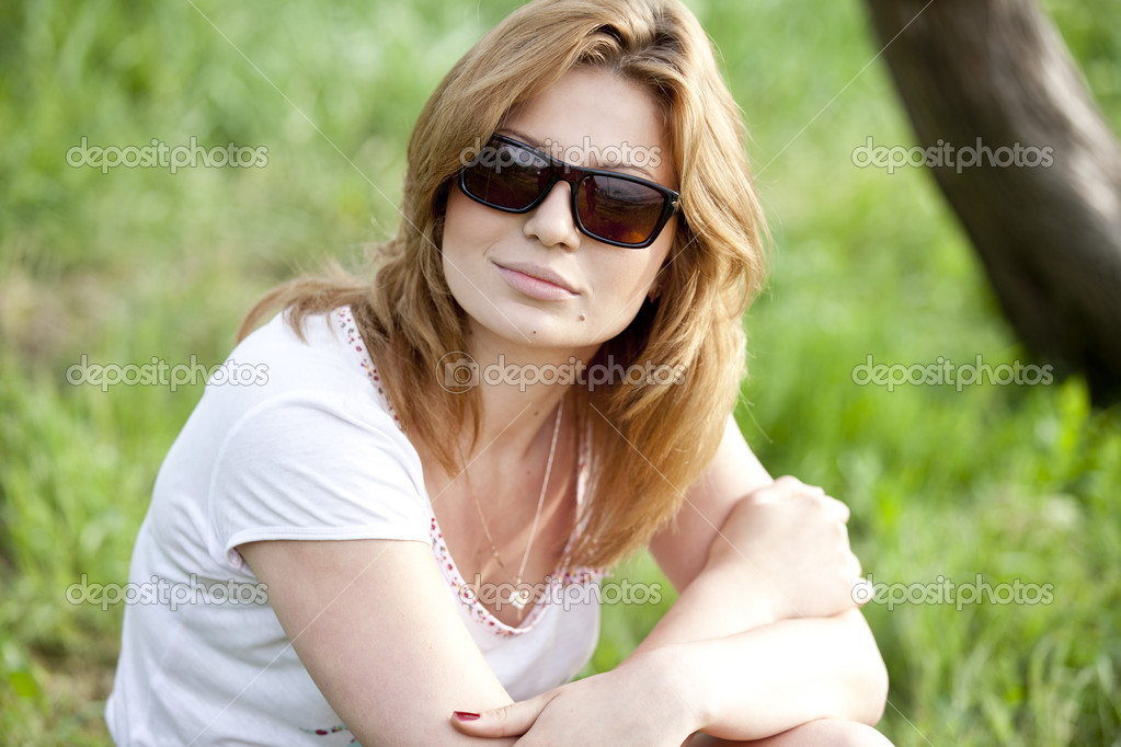 Blond girl in sunglasses at the summer park.  Stock Photo #10449345