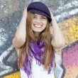 Style teen girl near graffiti wall. — Stock Photo