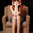 Redhead girl in armchair. 70s — Stock Photo #10549255