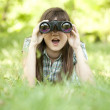 Teen girl with binocular at green grass — Stock Photo #10549316