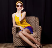 Redhead girl in armchair. 70s — Stock Photo