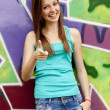 Style teen girl near graffiti background. — Stock Photo #10626018