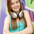 Style teen girl with sunglasses near graffiti background. — Stock Photo