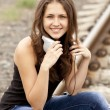 Teen girl with headphones at railways. — Stock Photo