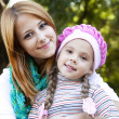 Mother and daughter at the park. — Stock Photo #7980461