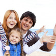 Stock Photo: Young family at the beach in fall.