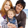 Young family at the beach in fall. — Stock Photo #7980476