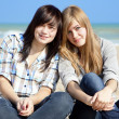 Two girls at outdoor near sea — Stock Photo #7980512