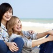 Two girls at outdoor near sea — Stock Photo #7980521