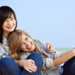 Two girls at outdoor near sea — Stock Photo #7980525