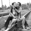 Couple kissing at railway. — Stock Photo #7980529