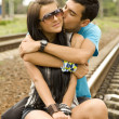 Stock Photo: Couple kissing at railway.