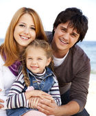 Young family at the beach in fall. — Stock Photo