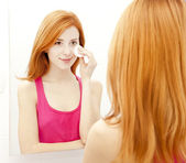 Beautiful redhead young woman with fresh skin of face in bathroo — Stock Photo