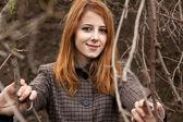 Redhead girl near tree. — Stock Photo