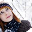 Beautiful young red-haired woman in winter park — Stock Photo