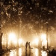 Stock Photo: Couple walking at alley in night lights. Photo in vintage multic