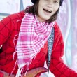 Closeup portrait of a happy young girl with guitar and graffiti — Stock Photo #8402142