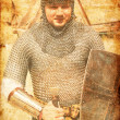 Photo of Knight and sword. Photo in old image style. — Stock Photo