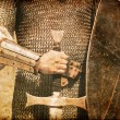 Photo of Knight and sword. Photo in old image style. — Stock Photo #8402293