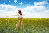 Beautiful young girl at green field — Stock Photo