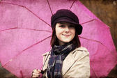 Girl in cloak and scarf with umbrella at park in rainy day. Phot — Stock Photo