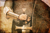 Photo of Knight and sword. Photo in old image style. — Foto de Stock