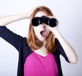 Teen redhead girl with binoculars — Stock Photo