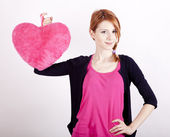 Beautiful red-haired girl with toy heart. Photo for st. Valentin — Stock Photo