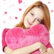 Beautiful red-haired girl with toy heart — Stock Photo #8670426