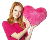 Beautiful red-haired girl with toy heart — Stock Photo