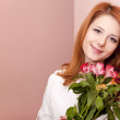 Redhead girl with flowers indoor. — Stock Photo #9081477