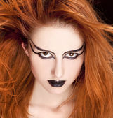 Closeup portrait of a red-haired female model on black background — Stock Photo