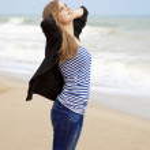 Funny girl at outdoor near sea. — Stock Photo #9487272