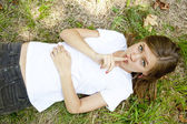 Girl lying and show silent symbol — Stock Photo