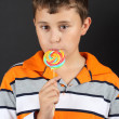 Boy eating lollipop — Stock Photo