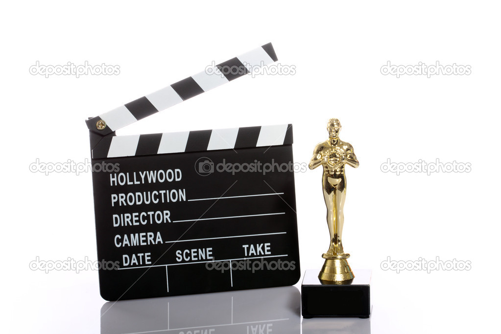 Movie clapper board and fake Oscar over white  Stock Photo #9591554