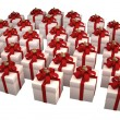 Many white gift boxes with red ribbon and bow isolated on white background — Stock Photo