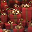 Beautiful red gift boxes with gold ribbon isolated on black 3D render ( hig — Stock Photo